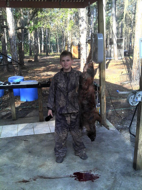 KIDS HUNTING 1ST HOG